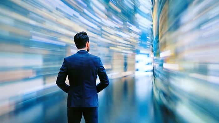 Business man observing fast speed data flow